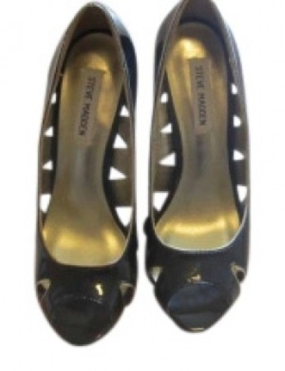 Preload https://item1.tradesy.com/images/steve-madden-black-and-gold-cut-out-heels-pumps-size-us-8-156200-0-0.jpg?width=440&height=440