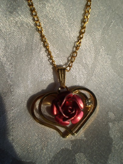 Unknown Vintage Rose on 2 hearts necklace