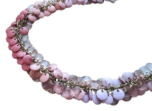 The Limited Limited Costume Necklace with Varying shades of Pink and Natural Tone Gems on a Gold Chain