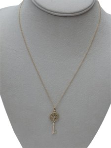 Tiffany & Co. 18k Daisy Key Pendant with diamond accent. W/ 16