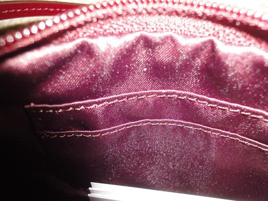 Coach Wristlet in Burgundy Red