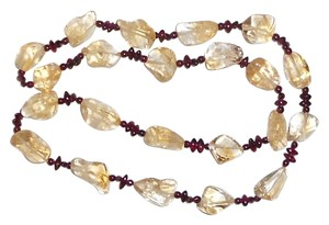 26 Inch's Of Real Garnet And Citrine quartz. 20 Citrine quartz Nuggets Each Around One inch.. No Clasp