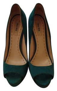 Miu Miu Teal Platforms