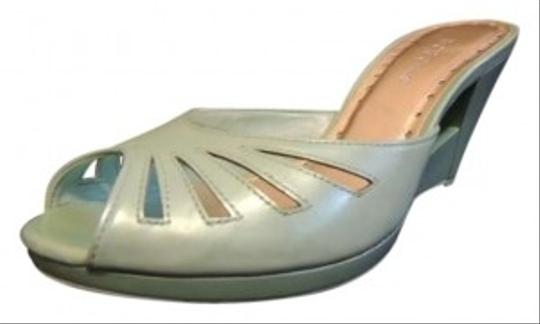 Preload https://item2.tradesy.com/images/bcbgirls-wedges-pastel-cutouts-icy-teal-sandals-156791-0-0.jpg?width=440&height=440