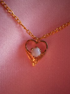 Like new Gold heart w/white opal necklace