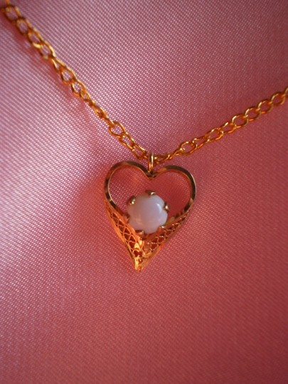Other Like new Gold heart w/white opal necklace
