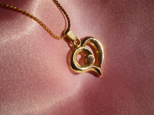 Other Like new Goldtone heart w/crystal necklace