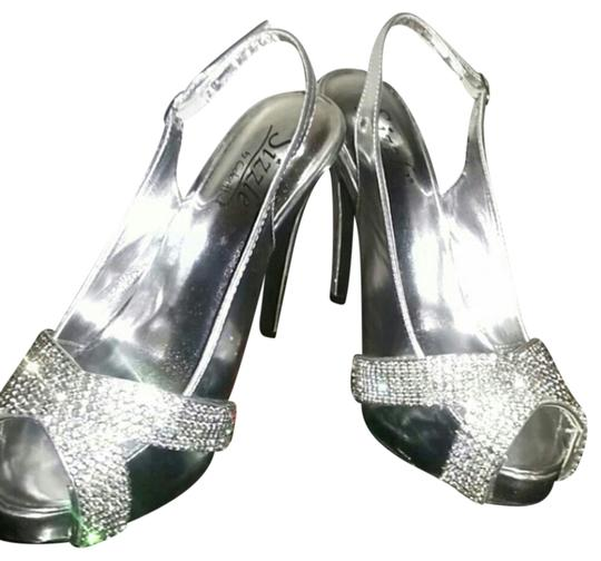 sizzle and Coloriffiac silver Platforms