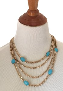Other 4 strand gold tone with turquoise stones necklace