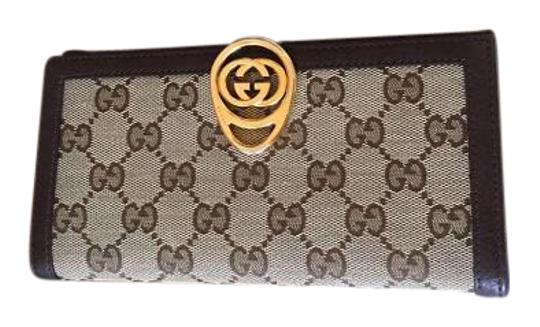 Preload https://item5.tradesy.com/images/gucci-brown-gg-wallet-15701419-0-1.jpg?width=440&height=440