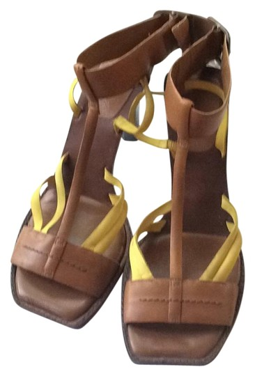 Preload https://item2.tradesy.com/images/dkny-yellow-and-brown-comfy-sandals-size-us-9-regular-m-b-15701506-0-1.jpg?width=440&height=440