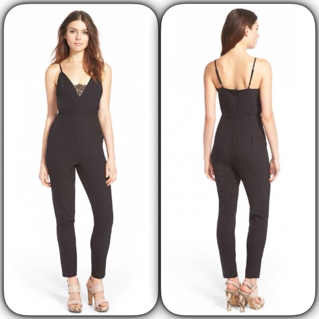 Preload https://img-static.tradesy.com/item/15705751/missguided-black-lace-panel-romperjumpsuit-0-4-650-650.jpg