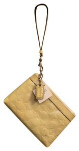 Coach Patent Leather Wristlet in Cream/Stone