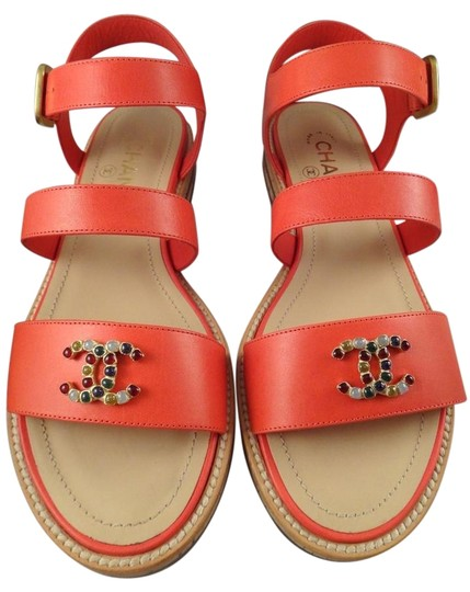 Preload https://item1.tradesy.com/images/chanel-red-coral-leather-cc-jewel-strappy-flats-395-sandals-size-us-95-regular-m-b-15711595-0-1.jpg?width=440&height=440