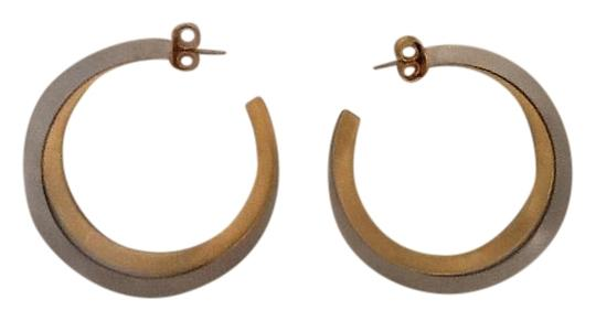 Preload https://item2.tradesy.com/images/silver-gold-reduced-hoop-two-tone-earrings-15714841-0-1.jpg?width=440&height=440
