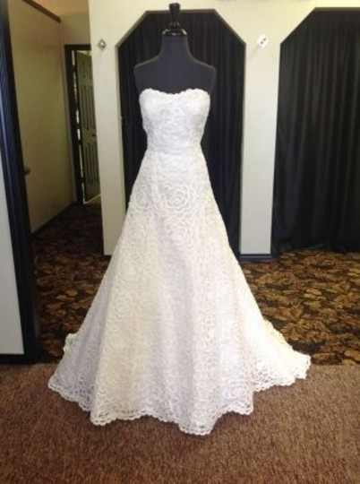 Preload https://img-static.tradesy.com/item/157168/jacquelin-exclusive-ivory-cut-out-lace-19887-feminine-wedding-dress-size-12-l-0-0-540-540.jpg