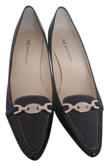 Preload https://item2.tradesy.com/images/anne-klein-black-leather-with-silver-broosh-pumps-size-us-7-regular-m-b-15719416-0-1.jpg?width=440&height=440