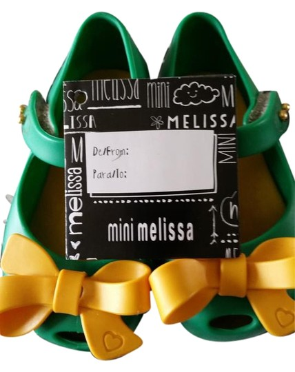 Preload https://item4.tradesy.com/images/green-with-yellow-bow-1085450-sandals-size-us-5-15720718-0-1.jpg?width=440&height=440