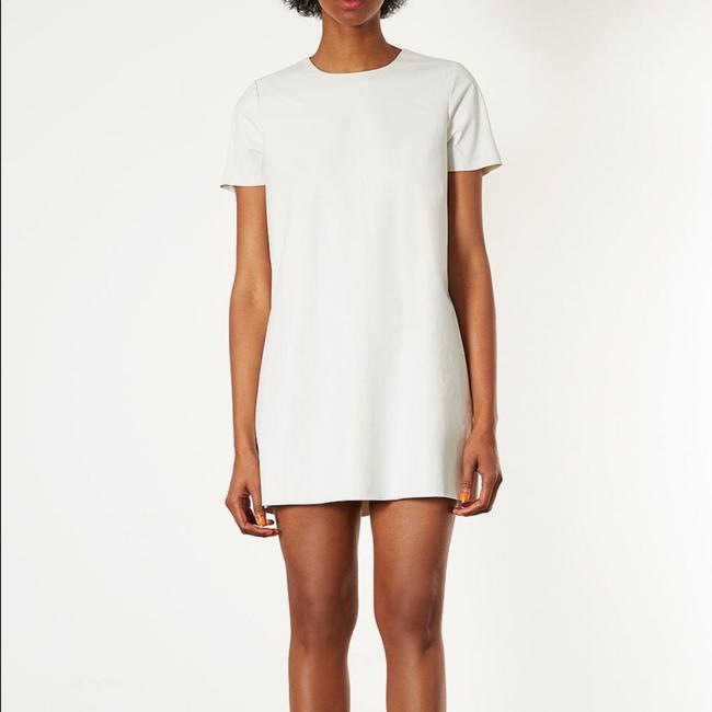 Preload https://item4.tradesy.com/images/topshop-leather-look-t-shirt-in-white-above-knee-short-casual-dress-size-12-l-15721843-0-2.jpg?width=400&height=650