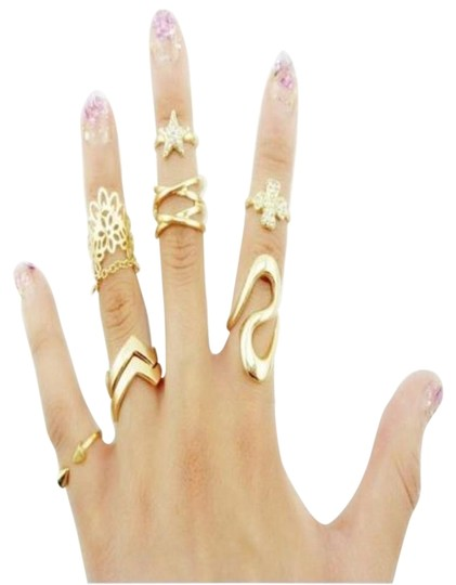 Preload https://img-static.tradesy.com/item/15726055/gold-women-s-fashion-clover-leaf-star-joint-knuckle-nail-set-of-7-ring-0-1-540-540.jpg
