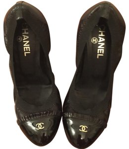 Chanel Black with gold accents Pumps
