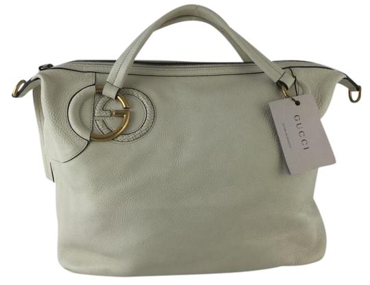 Preload https://item3.tradesy.com/images/gucci-pebbled-large-cream-leather-tote-1573797-0-2.jpg?width=440&height=440