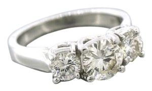 Exquisite 1.45ctw Round Brilliant Diamond Platinum Three-Stone Engagement Ring