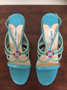 Jimmy Choo Blue with multi colored straps. Sandals