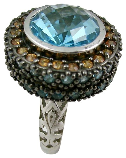 Preload https://img-static.tradesy.com/item/15796510/sima-k-blue-topaz-1142ct-and-gemstone-sterling-silver-size-7-ring-0-1-540-540.jpg