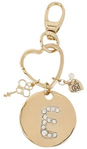 Betsey Johnson gilded key fob, marked by a crystal-embellished intital E