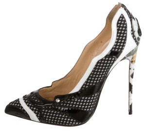 christian louboutin patent leather perforated pumps