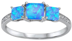 9.2.5 unique blue fire opal 3 stone ring size 7