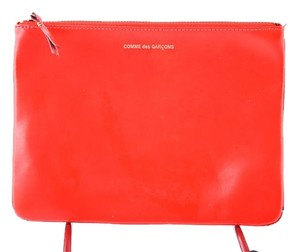 COMME des GARÇONS Orange Smooth Leather Pouch neon orange Clutch