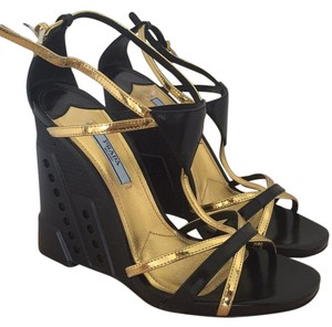 Prada Black and gold Wedges