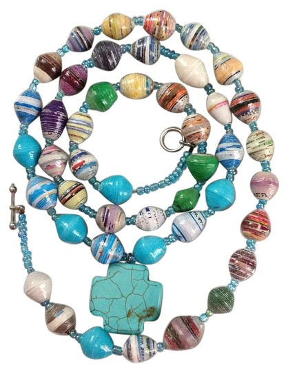 Preload https://img-static.tradesy.com/item/15840490/turquoise-multi-recycled-paper-and-cross-necklace-0-2-540-540.jpg