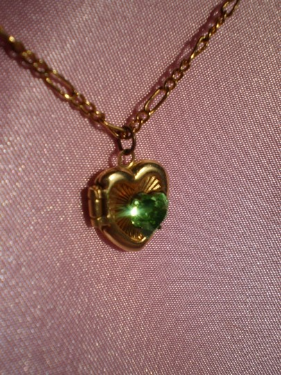 Preload https://item1.tradesy.com/images/gold-like-new-locket-wgreen-solitaire-necklace-158490-0-0.jpg?width=440&height=440