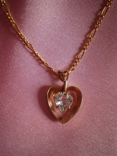 Preload https://img-static.tradesy.com/item/158496/gold-like-new-goldtone-heart-wsolitaire-necklace-0-0-540-540.jpg