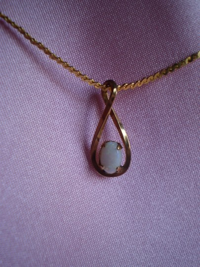 Trifari krussman Gold w/white fire opal necklace