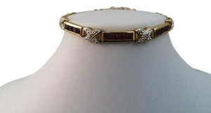 Sterling Silver, gold, ruby tennis bracelet.