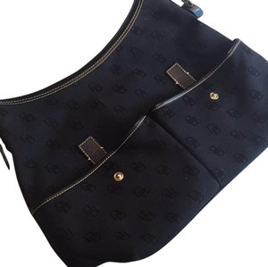 Authentic Dooney & Bourke hobo bag. Light weight with canvas materials. Great front pockets and great storage Hobo Bag