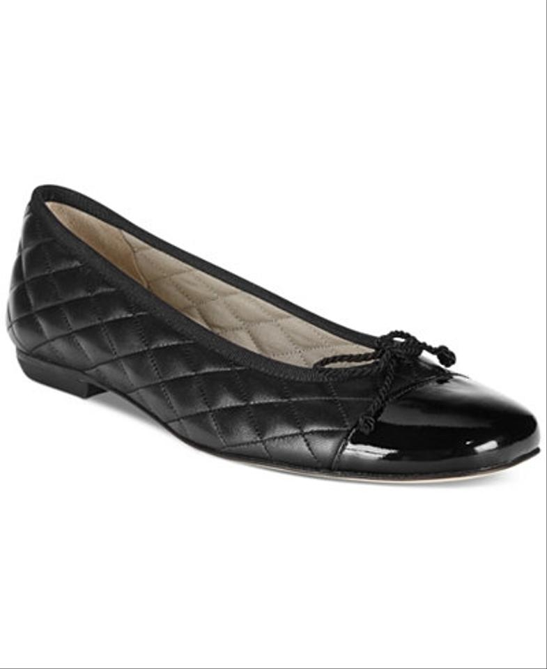 Scuffed Black Patent Leather Shoes