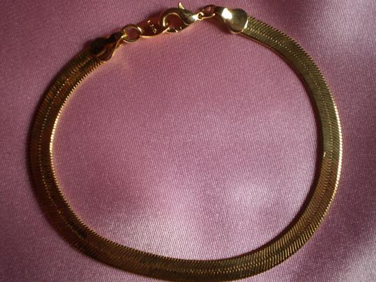 Other Like new Gold plated flat herringbone chain bracelet