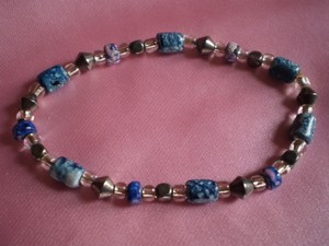 Unknown Like new Blue, Clear and Silver colored beads