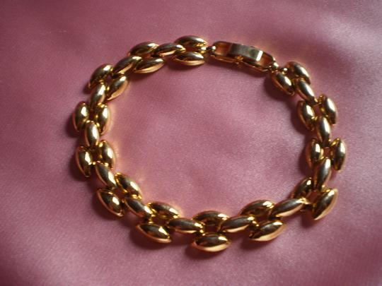 Unknown Goldtone panther link chain bracelet