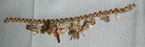 Gently Used 10k Yellow Gold Charm Bracelet with 10k & 14k Yellow Gold Charms