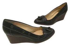 Cole Haan Tassels Stacked Wood Padded Insoles Nikeair Comfort Black leather and embossed leather Wedges
