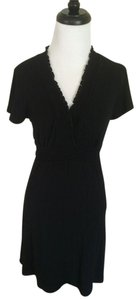 BCBGMAXAZRIA short dress Black Max Azria Short Sleeve Wrap on Tradesy