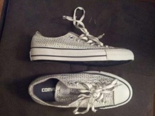 Preload https://item2.tradesy.com/images/converse-white-sparkly-bridal-chuck-taylor-s-all-stars-pants-size-us-65-159211-0-0.jpg?width=440&height=440