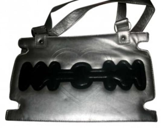 Preload https://item2.tradesy.com/images/tripp-nyc-silver-and-black-clutch-159241-0-0.jpg?width=440&height=440