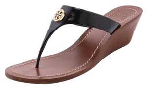 Tory Burch Black with brow sole Wedges